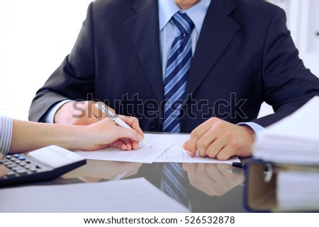 Bookkeepers or financial inspector making report, calculating or checking balance. Audit concept.