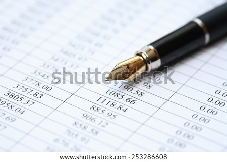 Bookkeeping concept. Closeup of fountain pen on paper background with digits - stock photo