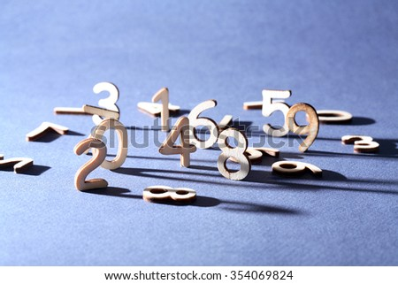 Bookkeeping symbol. Set of wooden digits on gray background - stock photo