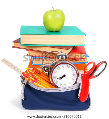 Books, an apple and school tools. On a white background. - stock photo