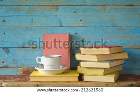 books and a cup of coffee, free copy space - stock photo