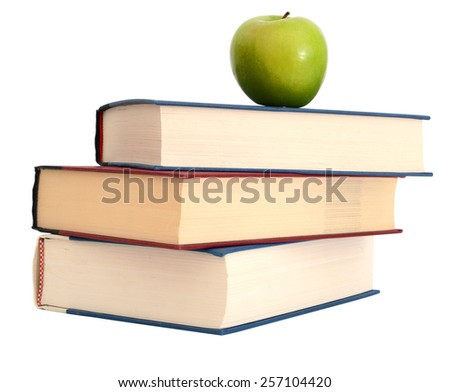 Books and a green apple. Isolation white background - stock photo