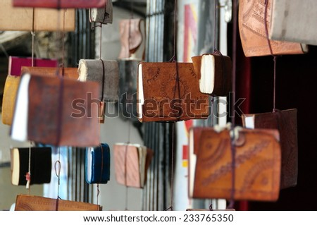 Books and agendas hanging outside at a shop in Udaipur, Rajasthan, India  - stock photo