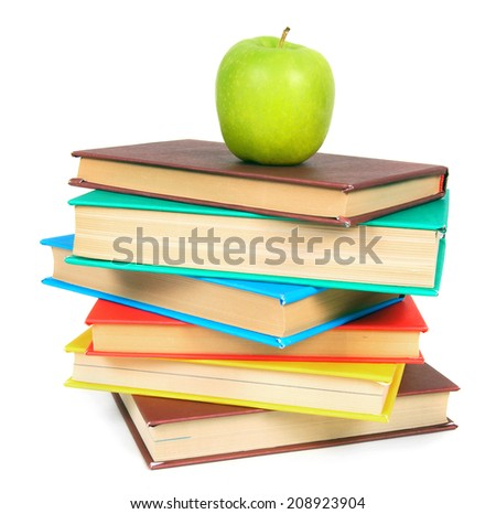 Books and an apple. On a white background. - stock photo