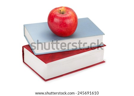 books and apple isolated on a white background - stock photo