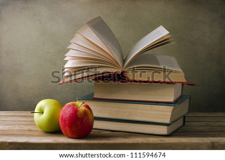Books and apples. Back to school concept. - stock photo