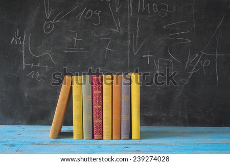 books and black board, learning, education concept, free copy space - stock photo