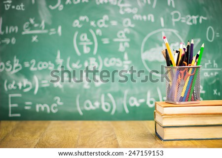 Books and blackboard, school supplies, back to school