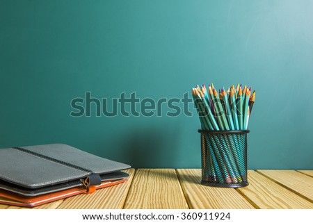 Books and blackboard, school supplies, back to school - stock photo