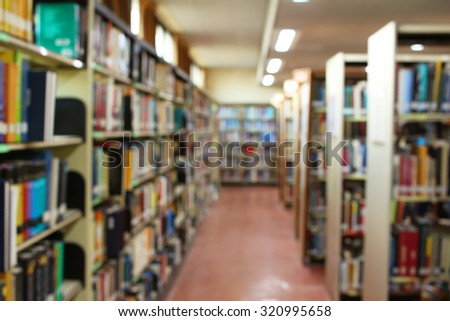 Books and bookshelf in a library de focused abstract background  - stock photo
