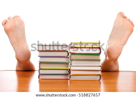 Books and Fallen Man under the Table on the White Background