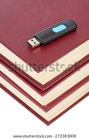 Books and flash memory isolated on white background - stock photo