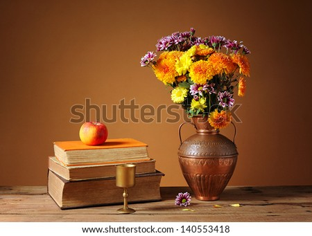 Books and flowers on the table - stock photo