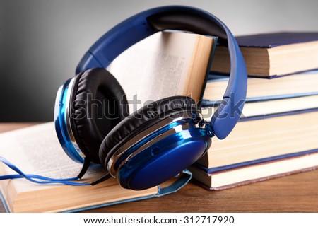 Books and headphones as audio books concept - stock photo