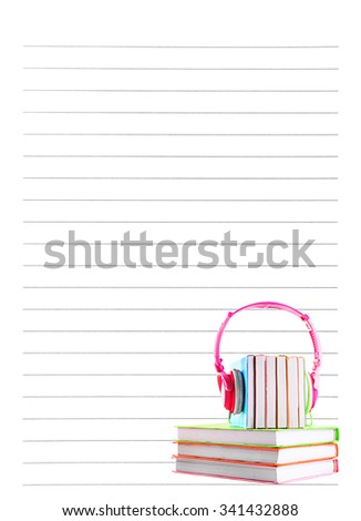 Books and headphones on lined paper background - stock photo