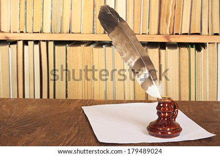 Books and medieval writing-materials on a table - stock photo