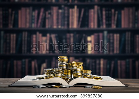 Books and money - stock photo