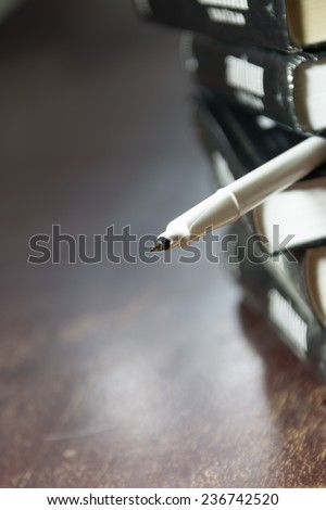 books and pen - stock photo