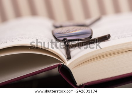 Books and reading  glasses  - stock photo