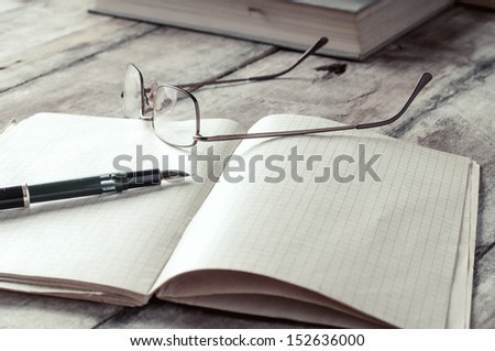 books and volumes on the table, close up - stock photo