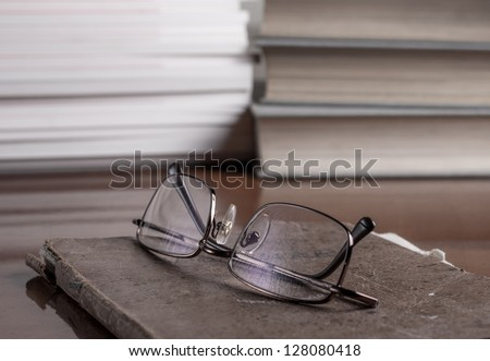books and volumes on the table,shallow depth of field - stock photo
