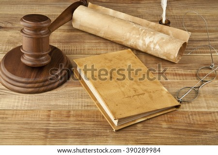 books and wooden gavel  on wooden background - stock photo