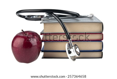books, Apple and stethoskop on white background - stock photo