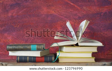 books arrangement, one opened, free copy space - stock photo