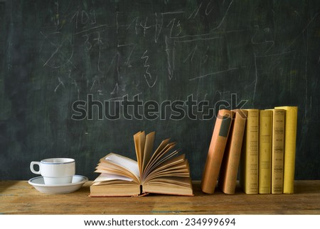 books, cup of coffee, blackboard, education,learning,science concept - stock photo