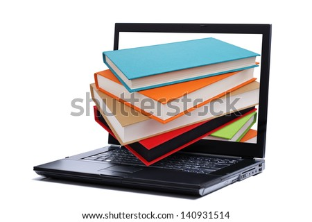 Books falling through a laptop computer monitor - stock photo