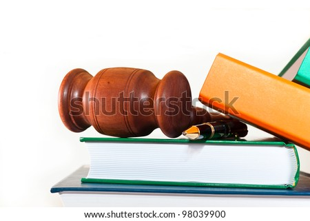 Books, folders, pen and gavel on a white background - stock photo