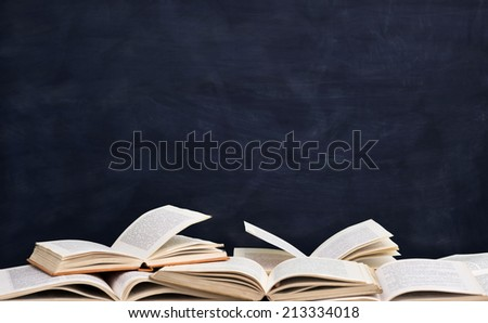 books front empty blackboard  - stock photo