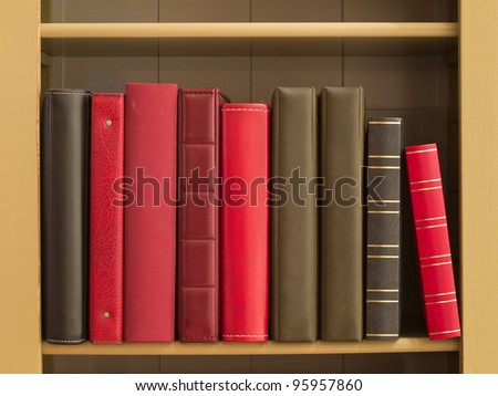 Books in a bookshelf as a background - stock photo