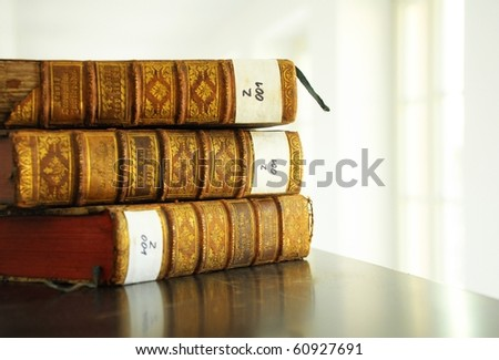 books in a library bookshelf for university education - stock photo