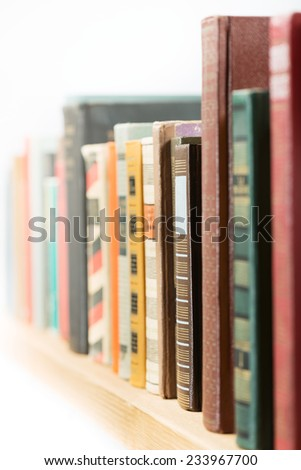 Books in a row. Shallow depth of field. - stock photo