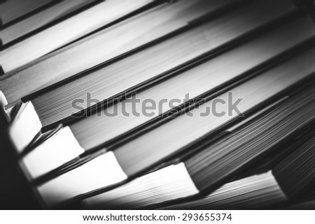 Books in Black and White Closeup Photo. Pile of Books. - stock photo