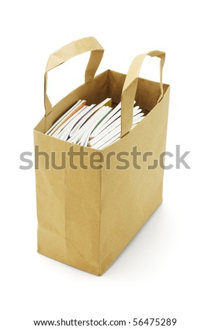 Books in paper bag isolated on white background - stock photo