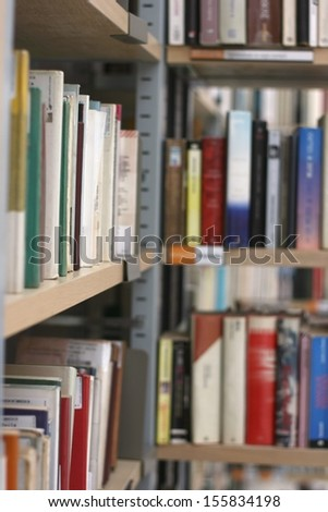 Books in public library, shallow DOF - stock photo