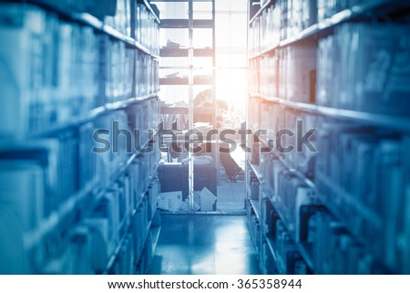 Books in public library, shallow DOF. - stock photo