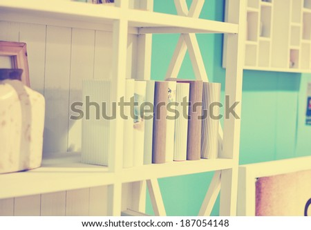 Books in shelf vintage - stock photo