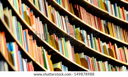 Books in tall Bookshelf, in public library - stock photo