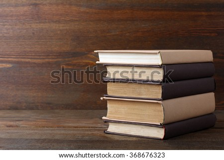 books in the light and dark cover folded stack on the wooden table