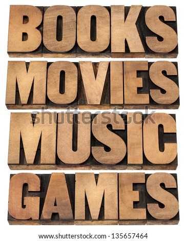 books, movies, music and games  - entertainment concept - collage of isolated words in vintage letterpress wood type printing blocks