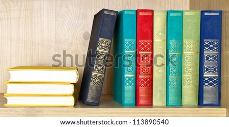 Books of various literary genres on shelf