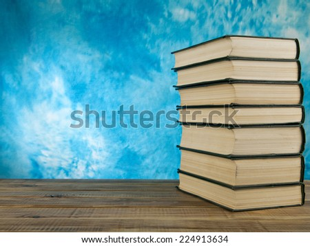 books on a blue background - stock photo