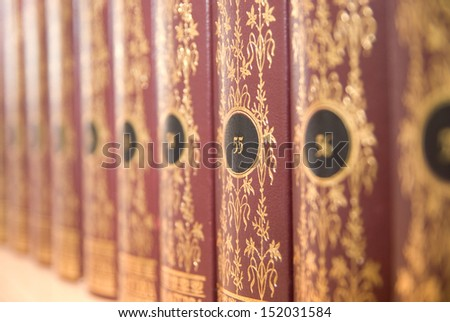 Books on a shelf in the library collection of works in the series. Background of the books - stock photo
