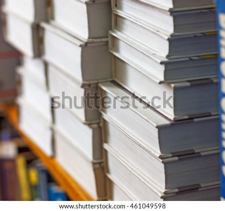 books on a shelf in the library, reading, and science education, stack of books piled volume hardcover