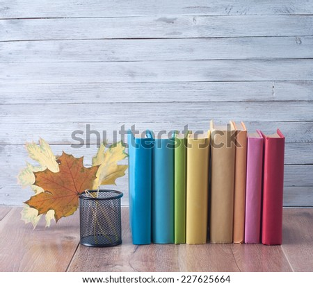 Books on a wooden background. - stock photo