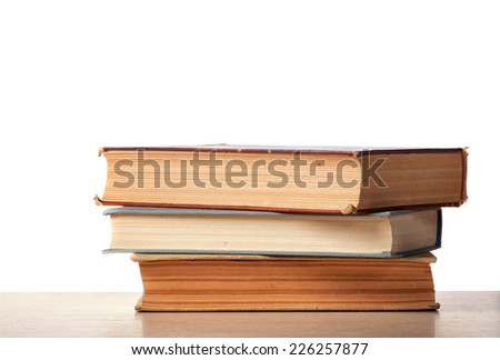 Books on desk with isolated background
