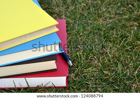 books on grass in campus